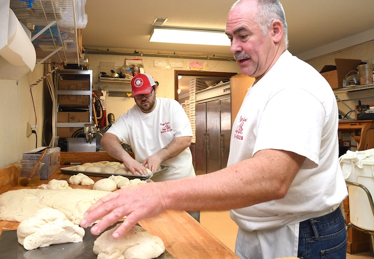 Tim Wygant, right, and his son Jordan, prepare pizza dough at Pizza Sam's.