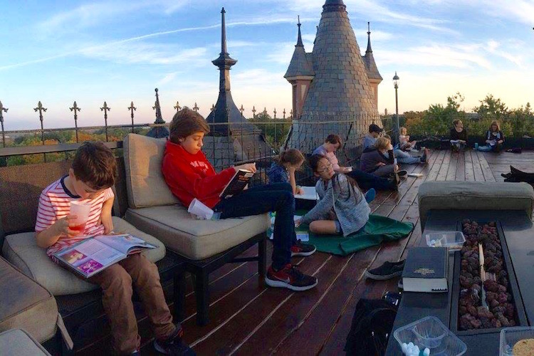 Reading club gathered on the roof of Henderson Castle