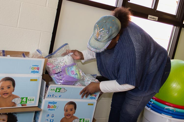 Denise Rucker, a program coordinator, started out as a volunteer with the diaper distribuiton program.
