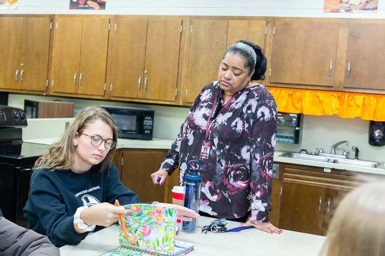 Lisa Boulding works with young people in a leadership program at Kalamazoo Central High School