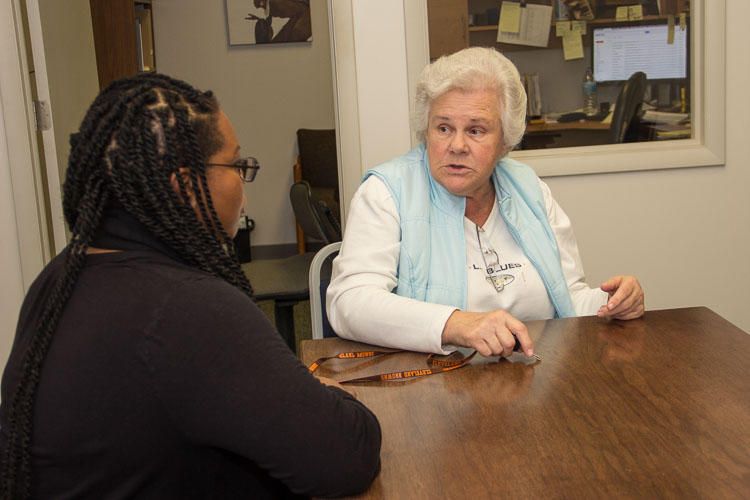 Alisa Parker, managing attorney at Legal Services of South Central Michigan, left, and client Phyllis Robinson