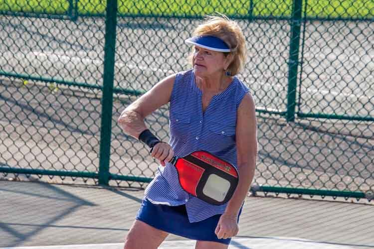Enjoying a game of Pickleball.