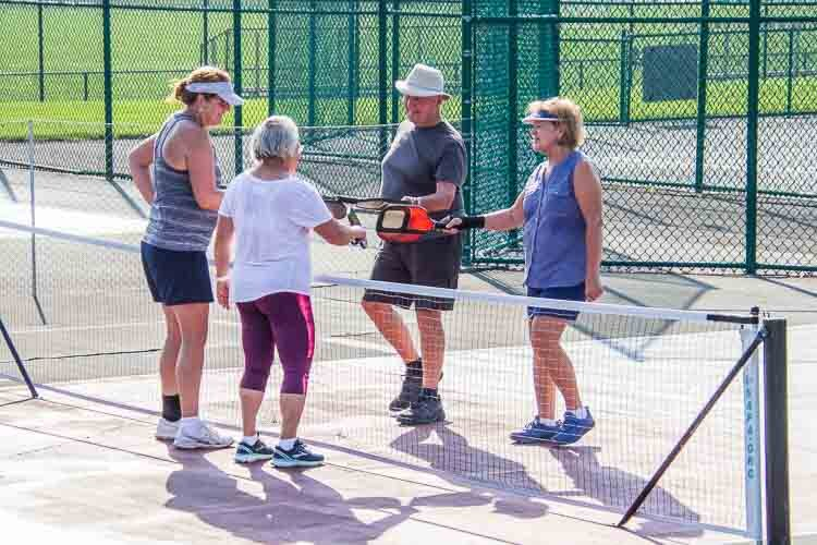 Battle Creek Pickleball Club members enjoy their time together.