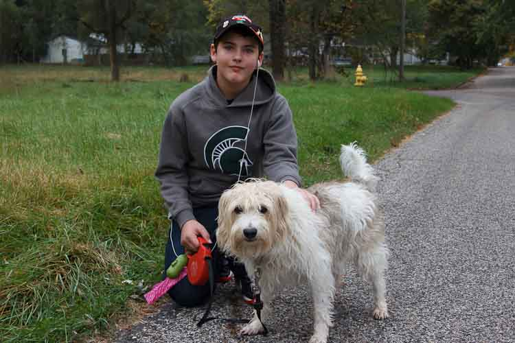 Damian Diamante started a dog walking service after taking a Generation E course. Photo by Susan Andress