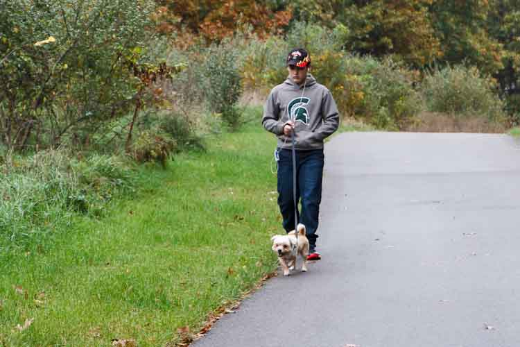 Damian Diamante started his own dog walking business. Photo by Susan Andress