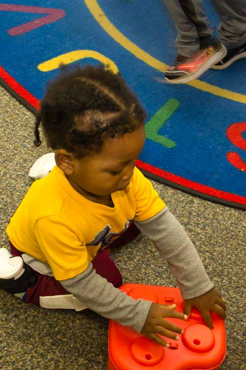 Playing to learn at Take-A-Break Childcare.
