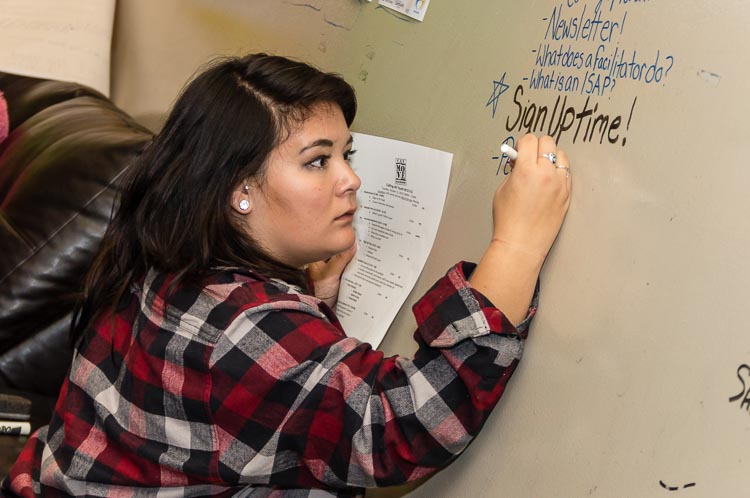 Rachel Cochran, Youth Peer Support Specialist, keeps track of young people's questions.