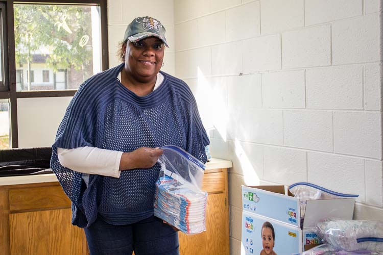 Denise Rucker, a program coordinator, started out as a volunteer with the diaper distribuiton program and her job expanded as the program grew.