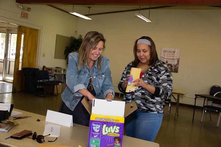 Kathy Szenda Wilson and Aliyah work together at a recent diaper distribution.