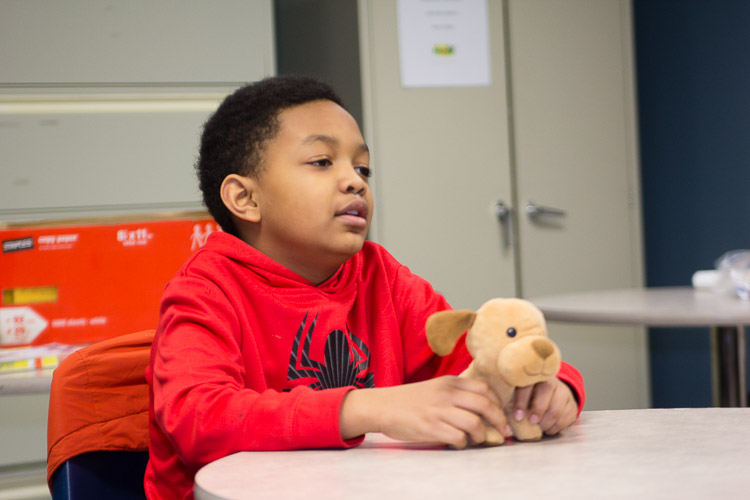 A stuffed puppy dog has a role in the fourth and fifth grade classroom of the after school program at New Genesis.
