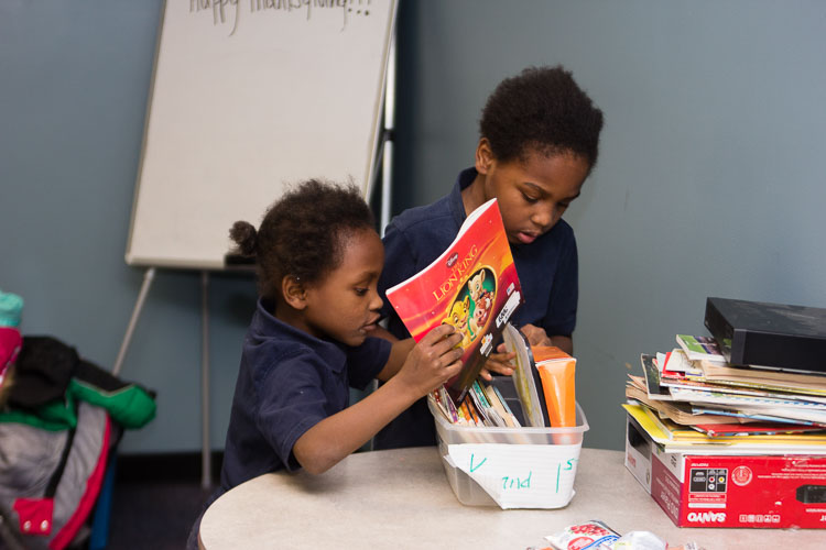 Youngsters enjoy their books at the New Genesis after-school program.
