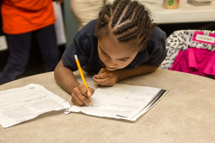 Youngsters' schoolwork is improving thanks to after school programs like the one at New Genesis