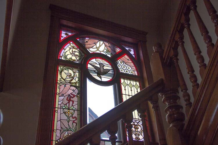 Stained glass windows are found in many places in the home.