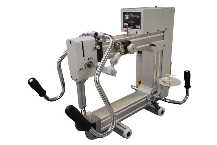 A longarm quilting machine sold by Accomplish Quilting