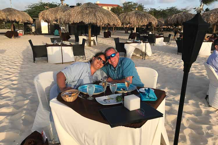 Lee and Lori Taylor enjoy an oceanside anniversary dinner in the Aruban sand.
