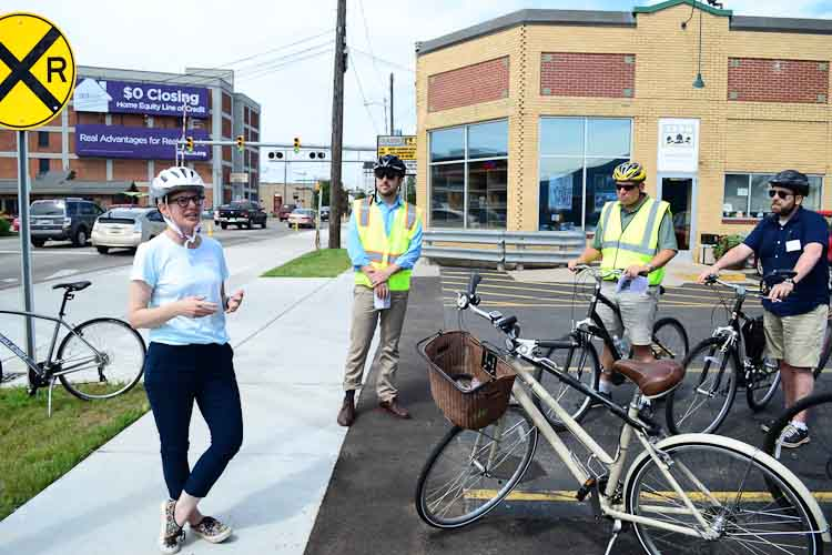 City Planning Director Rebekah Kik shows off the new bike lane in front Bell's in July.