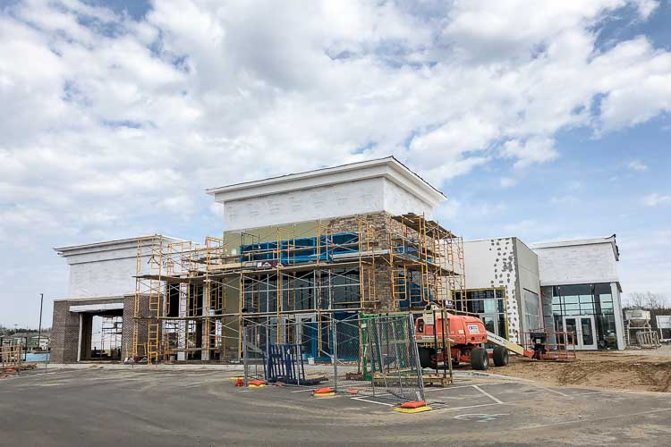 Construction underway at the Corner @ Drake retail center being developed by AVB.
