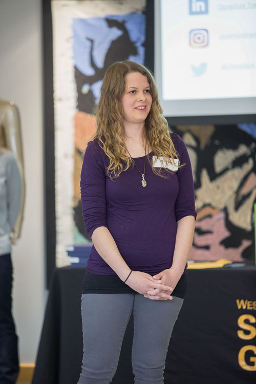 Desi Taylor talks about her business, Cluventure Travel, at Demo Day this March at Western Michigan University. Photo courtesy of  www.caseyspring.net
