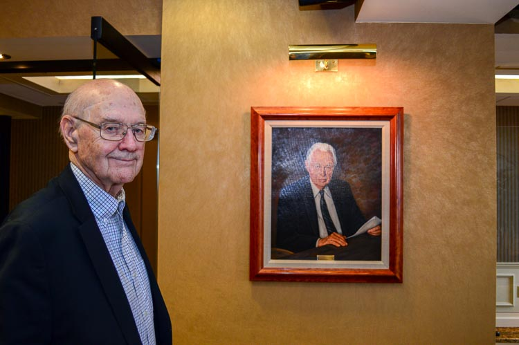 "Floyd ""Bud"" Parks with a portrait of Irivng S. Gilmore Photo Mark Wedel"
