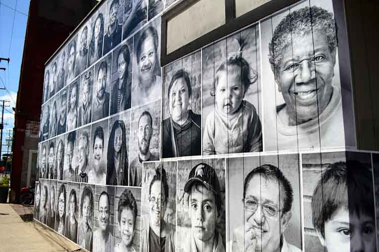 The faces of Edison residents cover much of the vacant Kalamazoo Color Lab. Photo by Mark Wedel
