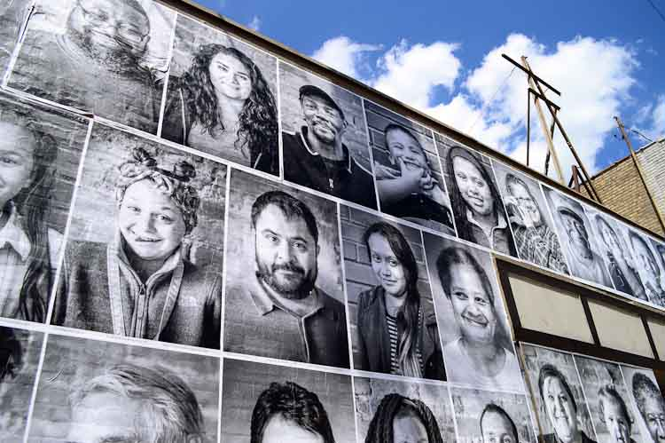 The portraits are meant to showcase the diversity of people and places in Edison, and to beautify spaces that have been or are currently vacant. Photo by Mark Wedel