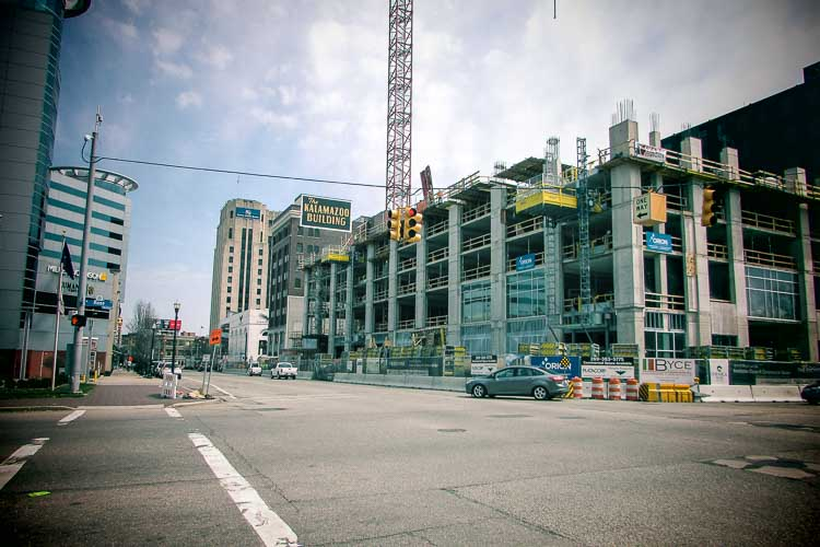 A large crane stands over the Exchange Building in downtown Kalamazoo.