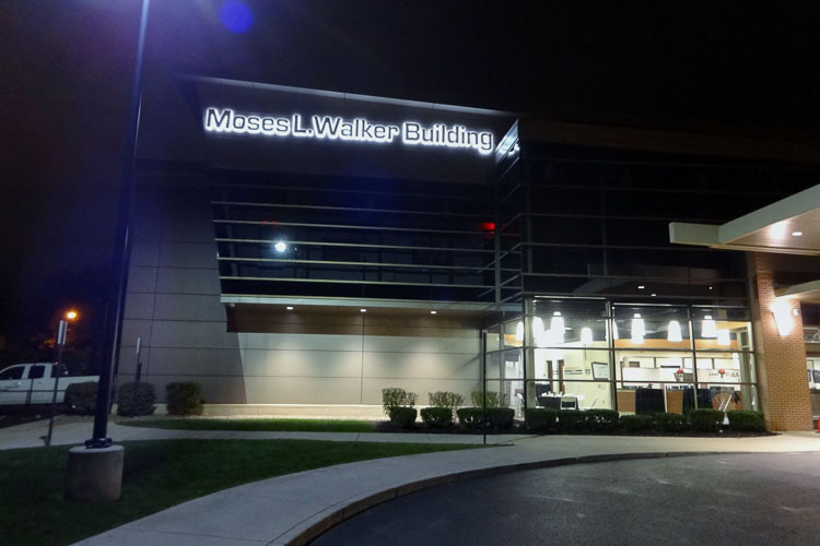Moses L. Walker Building sign at night