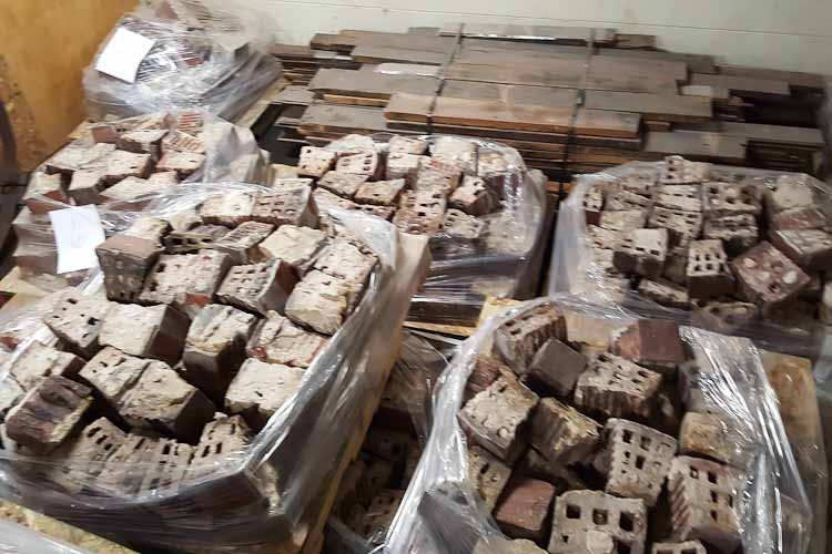 Pallets of bricks from the stack the community is trying to save