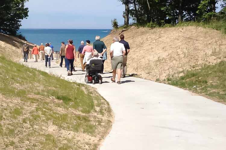 Beach goers take the barrier free walkway through Pilgrim Haven