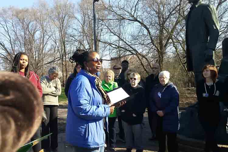 Denise Miller sharing a poem at the Underground Railroad monument in Battle Creek.