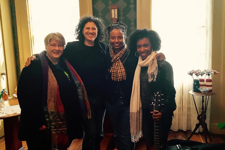 Patti Parker, hostess; Michelle Johnson, tour coordinator; Denise Miller, poet; and Nashon Holloway, musician at the Governor's Mansion in Marshall on the 2016 tour.