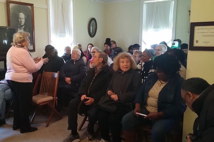 Nancy Rafferty speaking to the group at the Nathan Thomas Underground Railroad House in Schoolcraft in 2016.