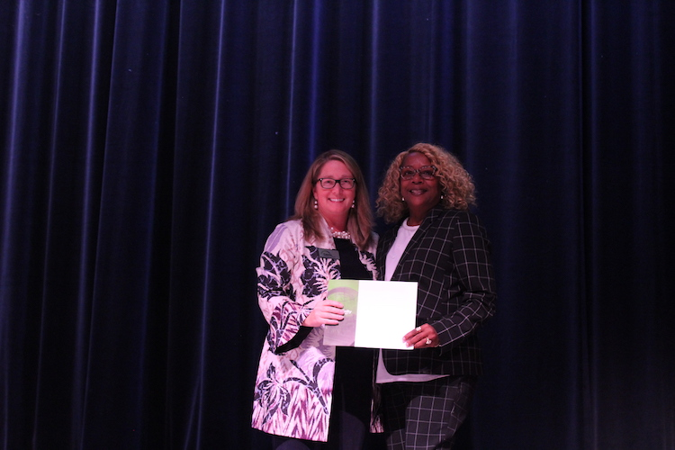 Kalamazoo Community Foundation President and CEO Carrie Pickett-Erway congratulates Charlene Taylor, who directs S.T.R.E.E.T., the winner of the foundation's Voting for a Cause initiative.