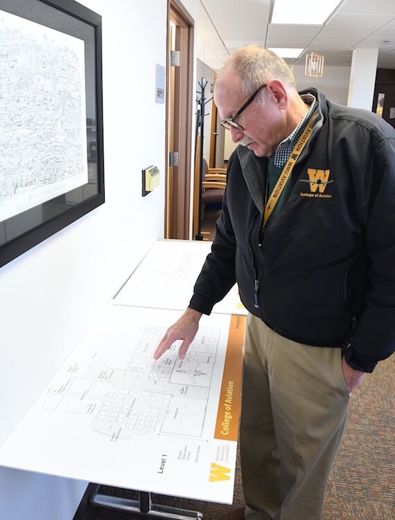 Dave Powell, dean of WMU's College of Aviation, looks over expansion plans.