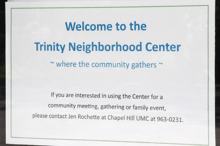 A sign on the front door of the Trinity Neighborhood Center
