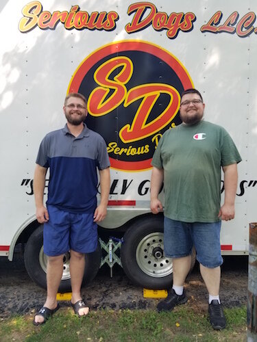 Thomas Woodin, at left, and his brother James, in front of their food truck in Battle Creek.