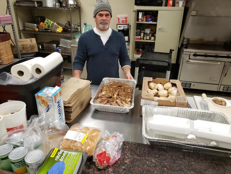 SHARE Center kitchen manager Brett Chew is making Salisbury steak for  dinner on April 1. He has been doing what SHARE Executive Director Robert Elchert describes as an awesome job as have his other staff members.