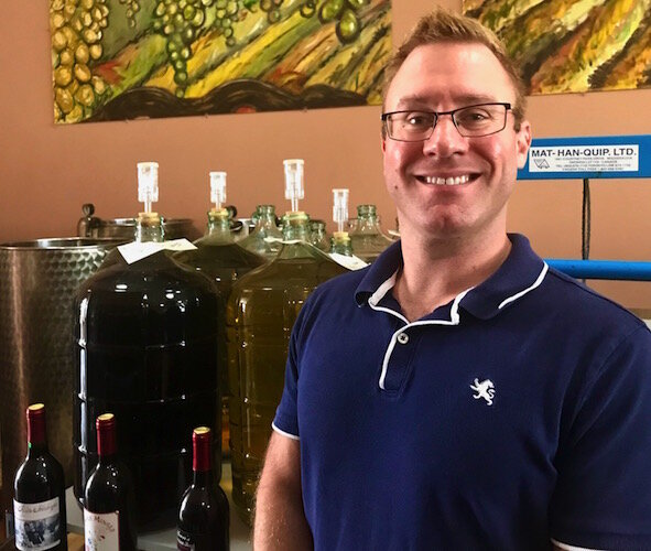 """It can't hurt,"" Alex Mantakounis, owner of Tempo Vino Winery of Kalamazoo, says of downtown Kalamazoo's new Social District plan, which will have commons areas that allow people to carry drinks outside as they visit shops and merchants."
