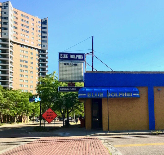 "The Blue Dolphin Restaurant, owned by Steve Stamos, sits at 502 S. Kalamazoo Mall, the southern end of Kalamazoo's planned Social District. Of entertainment during this age of the coronavirus, ""he says, It's about being able to walk around outside."""
