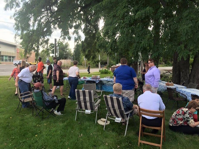 Before the COVID-19 pandemic prevented large in-person meetings, it was not unusual for neighbors to have barbecues and get-togethers. Stuart Area residents are shown at West Main Park, one of the city's oldest and smallest public parks.