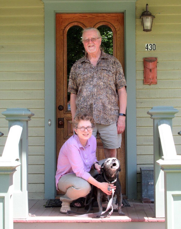 Sharon Carlson and her husband Tom Dietz are shown outside their 1880s vintage home with their dog Frank.