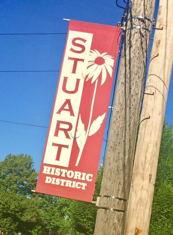 A banner lets people know they are in the Stuart Neighborhood.