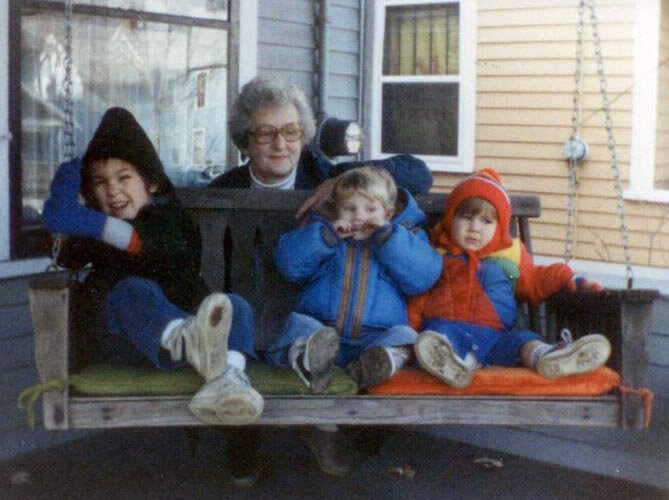 Grandma Charlotte Ferraro gathers with a few of her grandchildren on the famous Ferraro porch swing.