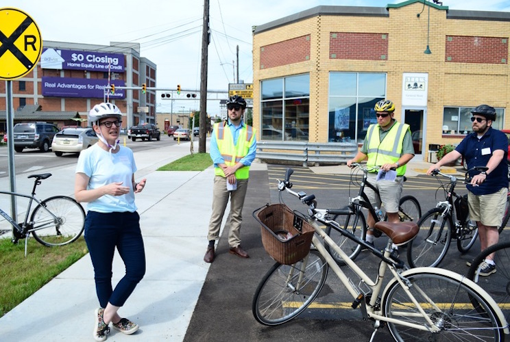 Rebekah Kik, Kalamazoo Community Planning and Development director, shows off the city's new protected bike lane on Kalamazoo Avenue.