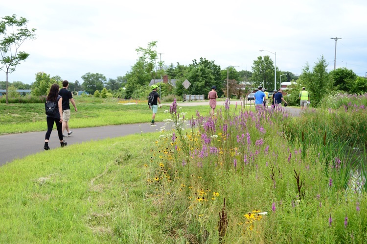 Training Wheels group, on foot, inspects new trail along Portage Creek.