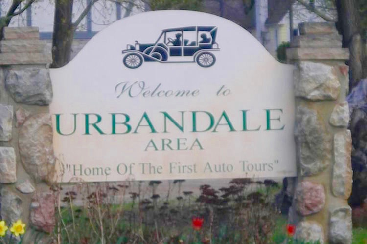 "Signs proclaiming Urbandale as the ""Home of First Auto Tour"" have an interesting history."