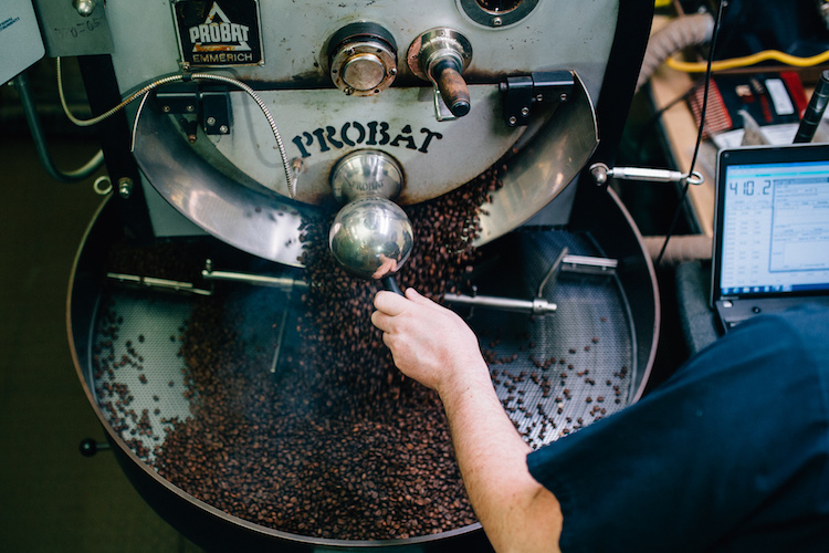 Working with the beans at the Water Street Roaster