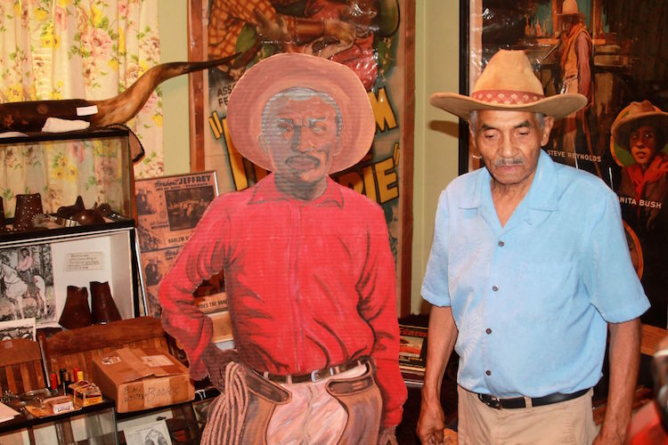 Murphy Darden visited schools with his life-size cardboard cutouts of African American cowboys telling the stories he's learned along the way.