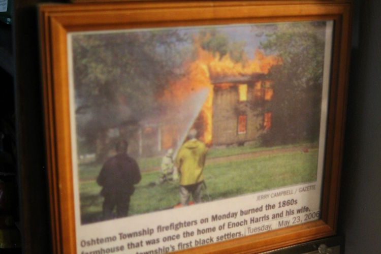 Capturing the history of the burning of the home of Oshtemo's first black settlers Enoch and Deborah Harris as firefighters practiced putting out a blaze.