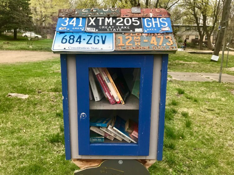 A book nook at Adda Dilts Peace Park on Forbes Street in the West Douglas Neighborhood, is covered by license plates from all over the United States.